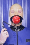 Dildo harness with inflatable gag option lockable