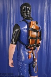 Enema backharness with enema bag and plug